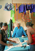 Gloria Cummins preparing costumes, Flamboyan, Fernhead Road, North Paddington, 2001.