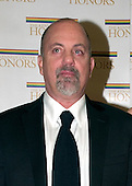 "Billy Joel arrives at the Harry S. Truman Building (Department of State) in Washington, D.C. on December 4, 2004 for a dinner hosted by United States Secretary of State Colin Powell.  At the dinner six performing arts legends will receive the Kennedy Center Honors of 2004.  This is the 27th year that the honors have been bestowed on ""extraordinary individuals whose unique and abundant artistry has contributed significantly to the cultural life of our nation and the world"" said John F. Kennedy Center for the Performing Arts Chairman Stephen A. Schwarzman.  The award recipients are: actor, director, producer, and writer Warren Beatty; husband-and-wife actors, writers and producers Ossie Davis and Ruby Dee; singer and composer Elton John; soprano Joan Sutherland; and composer and conductor John Williams..Credit: Ron Sachs / CNP"
