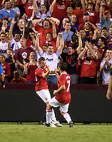 Michael Owen (7) celebrates his game winning goal with teammate Tom Cleverly (35) of Manchester United during the friendly at FedEX Field in Landover, MD.  Manchester United defeated FC Barcelona, 2-1.