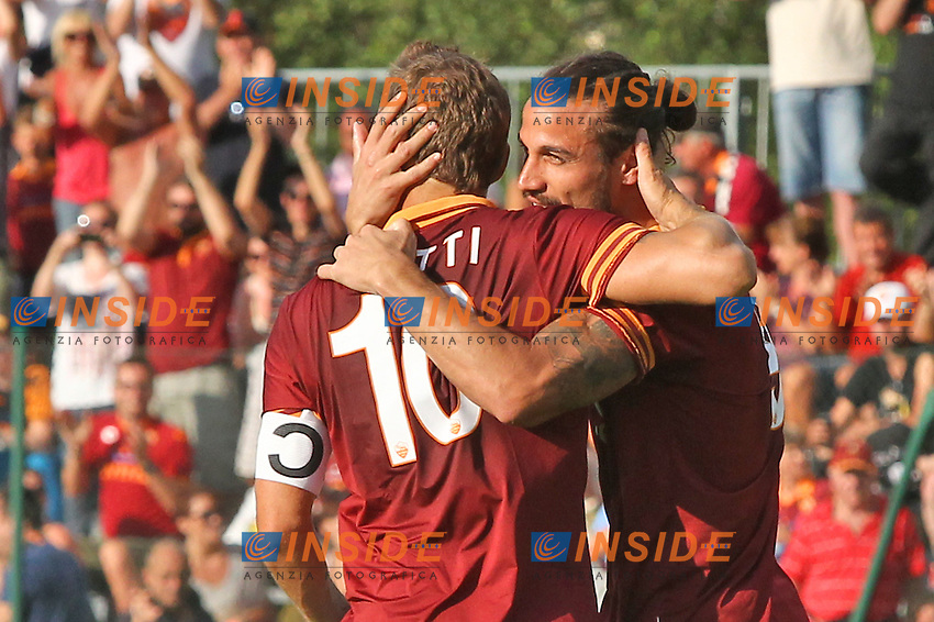 Francesco Totti e Pablo Osvaldo esultanza<br /> Riscone (Brunico) 21.7.2013 <br /> Football Calcio 2013/2014 Serie A<br /> Ritiro precampionato AS Roma <br /> As Roma pre season training<br /> Roma-Bursaspor Partita Amichevole Friendly Match<br /> Foto Gino Mancini / Insidefoto