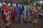 Heydi Foster (center), the CEO of Mision Cara, poses with women in a sewing workshop sponsored by the Catholic parish in Bunj, South Sudan. The community is host to more than 130,000 refugees from the Blue Nile region of Sudan, and Misean Cara has supported Jesuit Refugee Service and the parish as they work to provide services to both refugees and the host community.