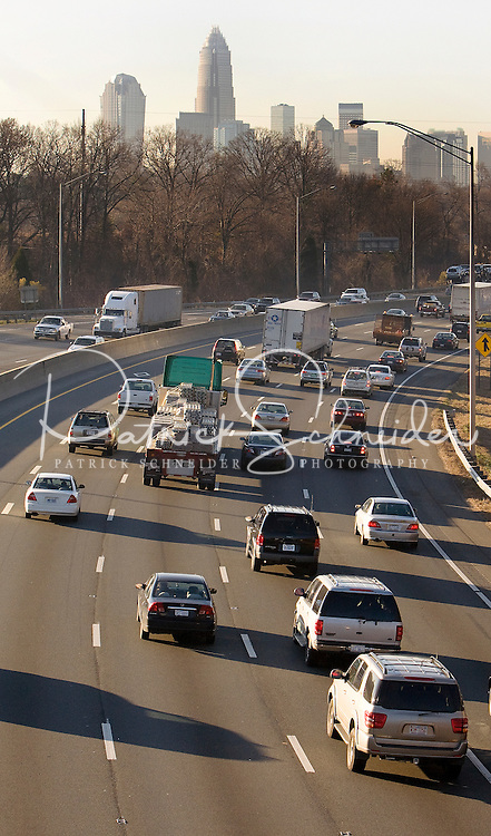 Highway traffic in Charlotte, NC..Charlotte, the largest city in North Carolina and the 20th-largest city in the country, is one of the nation?s fastest-growing areas. Experts say the Charlotte population has grown 46 percent between 1990 and 2006.