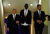 Enrique Crezo (l), Josuha Guilavogui and José Luis Pérez Caminero during the official presentation as an Atletico de Madrid´s new football player in Vicente Calderon Stadium, Madrid. September 13, 2013. (ALTERPHOTOS/Victor Blanco)