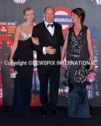 """PRINCESS CHARLENE, PRINCE ALBERT AND PRINCESS CAROLINE OF MONACO.attend one of the Principality's premiere event the """"Bal de la Rose"""" (Monaco Rose Ball).The theme for this year's Ball that raise funds for the Princess Grace Foundation was """"Swinging London""""_Monte Carlo, 24/03/2012.Mandatory Credit Photos: SBM/Newspix International..**ALL FEES PAYABLE TO: """"NEWSPIX INTERNATIONAL""""**..PHOTO CREDIT MANDATORY!!: NEWSPIX INTERNATIONAL(Failure to credit will incur a surcharge of 100% of reproduction fees)..IMMEDIATE CONFIRMATION OF USAGE REQUIRED:.Newspix International, 31 Chinnery Hill, Bishop's Stortford, ENGLAND CM23 3PS.Tel:+441279 324672  ; Fax: +441279656877.Mobile:  0777568 1153.e-mail: info@newspixinternational.co.uk"""