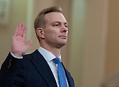 David A. Holmes, Political Counselor, United States Embassy in Kyiv, Ukraine, on behalf of US Department of State, is sworn-in to testify during the US House Permanent Select Committee on Intelligence public hearing as they investigate the impeachment of US President Donald J. Trump on Capitol Hill in Washington, DC on Thursday, November 21, 2019.<br /> Credit: Ron Sachs / CNP<br /> (RESTRICTION: NO New York or New Jersey Newspapers or newspapers within a 75 mile radius of New York City)