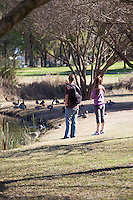 Young Couple At El Dorado Regional Park In Long Beach California