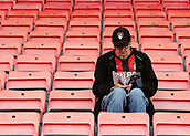 30th September 2017, Vitality Stadium, Bournemouth, England; EPL Premier League football, Bournemouth versus Leicester; A Bournemouth fans takes to his seat early and takes a look at the Matchday Programme