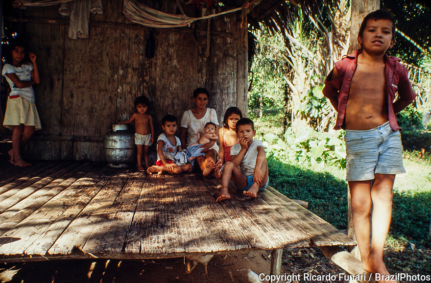 Brazilian Amazon riverine family - ribeirinho, those who live near the rivers and have artisanal fishing as the main survival activity and also cultivate small clearings for own consumption and can practice extractive activities - Amazonas State, Brazil.