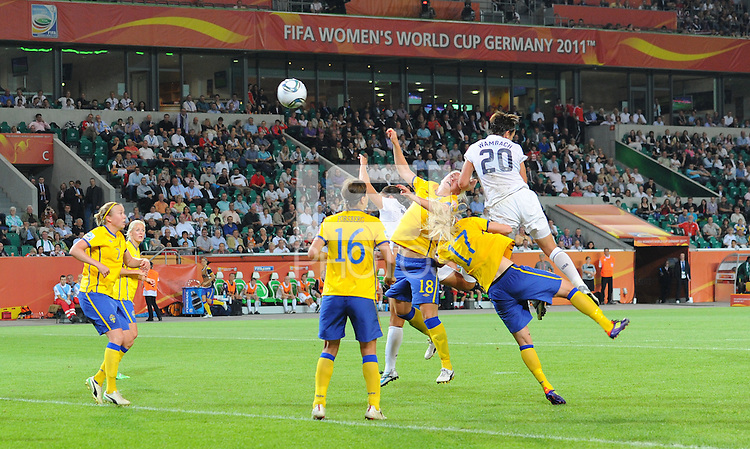 Abby Wambach (r) of team USA scores 1:2 during the FIFA Women's World Cup at the FIFA Stadium in Wolfsburg, Germany on July 6thd, 2011.