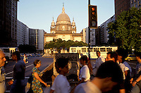 Rush hour foot traffic crosses busy Avenida Presidente Vargas in Rio's banking district. Behind is the historic Candelária church where eight street children were shot by off-duty police in 1993.