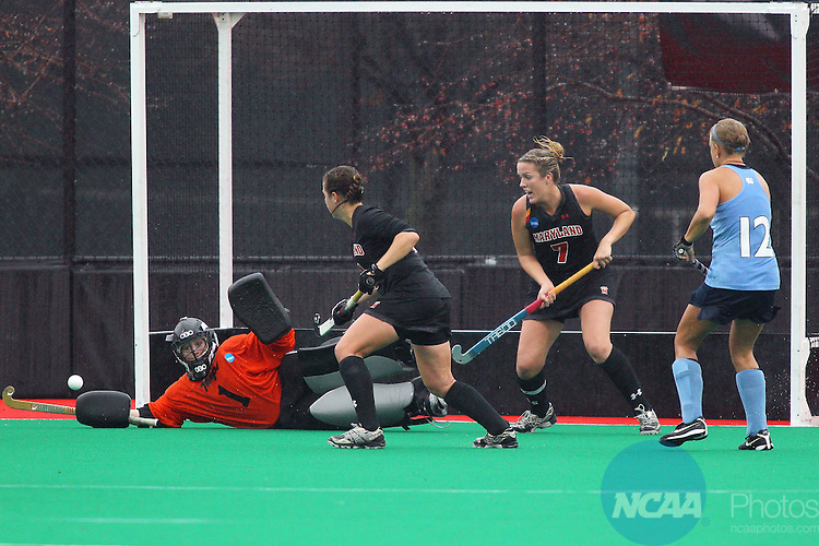 20 NOV 2011:  Goalie Melissa Vassalotti (1) of the University of Maryland blocks a shot by Katie Plyler (12) of the University of North Carolina during the Division I Women's Field Hockey Championship between Maryland and North Carolina was held at Trager Stadium on the University of Louisville campus in Louisville, KY. Maryland defeated North Carolina 3-2 in overtime to win the national title. Jonathan Palmer/ NCAA Photos
