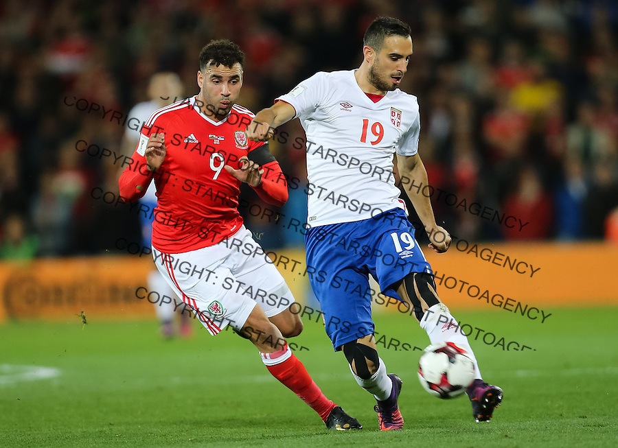 (copyright &amp; photo: STARSPORT)<br /> 12.11.16 - Wales v Serbia, FIFA World Cup Qualifier 2018 - Nikola Maksimovic of Serbia holds off Hal Robson-Kanu of Wales