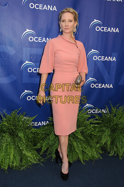Anne Heche<br /> 6th Annual Oceana SeaChange Gala held at a Private Villa, Laguna Beach, California, USA. <br /> August 18th, 2013<br /> full length pink dress clutch bag gold black shoes <br /> CAP/ADM/BP<br /> &copy;Byron Purvis/AdMedia/Capital Pictures