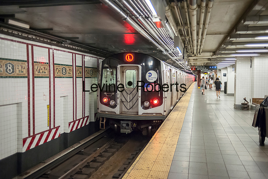 "The Canarsie Line ""L"" train departs its Eighth Avenue terminal in New York on Monday, July 25, 2016. Because of salt water damage to the Canarsie tunnel from Hurricane Sandy the MTA will close the line down in Manhattan for 18 months affecting hundreds of thousands of commuters. Trains will end at Bedford Avenue and the shutdown will start in 2019. ( © Richard B. Levine)"
