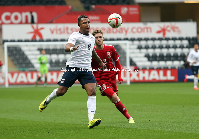 Pictured L-R: Liam Moore of England is challenged by Wes Burns of Wales. Monday 19 May 2014<br /> Re: UEFA Euro Under-21 Qualifier, Wales v England at the Liberty Stadium, Swansea, south Wales, United Kingdom