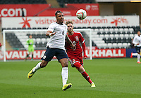 Pictured L-R: Liam Moore of England is challenged by Wes Burns of Wales. Monday 19 May 2014<br />