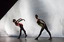 London, UK. .27.09.2013. Cedar Lake Contemporary Ballet present a Triple Bill at Sadler's Wells. This piece is INDIGO ROSE by Jiri Kylian. Dancers are: Billy Bell, Jonathan Bond, Vania Doutel Vaz, Jason Kittelberger, Joseph Kudra, Navarra Novy-Williams, Joaquim de Santana, Ebony WIlliams, Jin Young Won. Picture shows: Vania Doutel Vaz and Novarra Novy-Williams. Photograph © Jane Hobson, 2013.