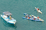 tourists in boats in the pacific ocean near kicker rock and peurto bacquerizo moreno galapagos san cristobal