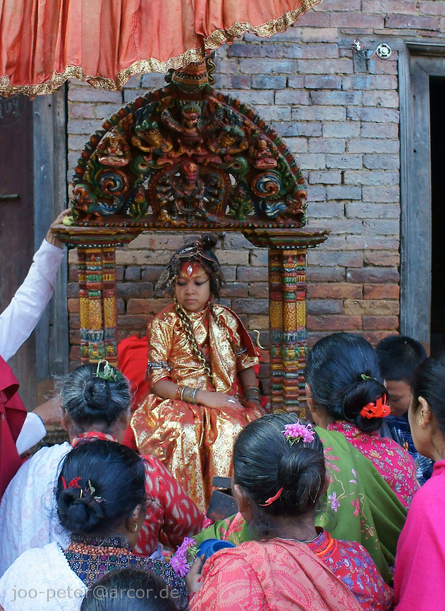 Kumari is the tradition of worshipping a ritual selected young prepubescent girl as manifestation of the divine female energy or devi in Hindu  tradition. Kumari means young unmarried girl (Kumar means unmarried man, both names are also popular first names in Nepal).