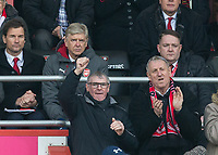 Supporters celebrate around Arsenal Manager as Bournemouth equalise during the Premier League match between Bournemouth and Arsenal at the Goldsands Stadium, Bournemouth, England on 14 January 2018. Photo by Andy Rowland.