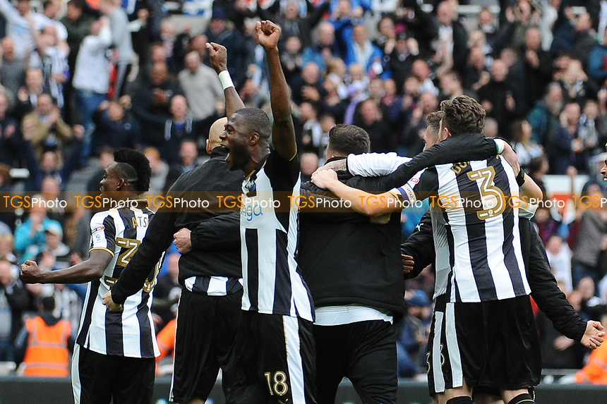 Chancel Mbemba of Newcastle United celebrates as Newcastle United are confirmed as champions during Newcastle United vs Barnsley, Sky Bet EFL Championship Football at St. James' Park on 7th May 2017