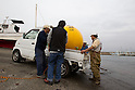 (File Photo) Hiratsuka, Japan - In the file photo released on November 25, 2011 shows Cosmo Power Co., Ltd. employees unloading Noah's Ark into the water at a port in Hiratsuka, Kanagawa Prefecture, October 20, 2011. Shoji came up with the idea to make Noah's Ark after watching the torrential rain that hit Kyushu approximately 4 years ago. His primary vision for the company is to make products that can save as many people in the future from large natural disasters. The construction process to fully complete a single capsule takes one day but the company aims to make 20 per day. There are currently two models of the safety capsules that can fit up to 4 people (1,200mm) (priced at 315,000 Japanese Yen) and 6 people (1,500mm) (priced at 471,450 Japanese Yen). There has been a demand of buyers for Noah's Ark from countries such as the United States, Brazil, China, Thailand, Bangladesh and New Zealand, however, the company is not ready to sell overseas at present. Shoji mentioned that he plans to make a more advanced model of Noah's Ark in the near future. (Photo by: Christopher Jue/AFLO)