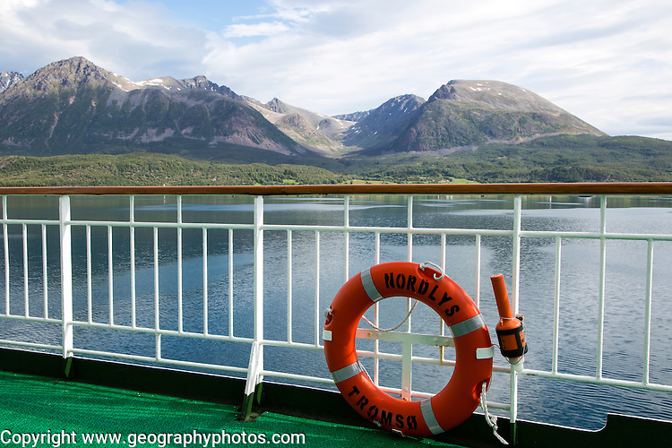 Steep mountains of Grytoya island, Troms county, northern Norway from Hurtigruten ferry ship Nordlys