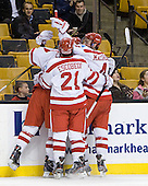 Alex Chiasson (BU - 9), Sean Escobedo (BU - 21), Patrick MacGregor (BU - 4) - The Boston University Terriers defeated the Harvard University Crimson 3-1 in the opening round of the 2012 Beanpot on Monday, February 6, 2012, at TD Garden in Boston, Massachusetts.