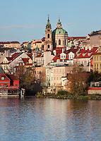 The Vltava river and the Baroque St Nicholas church or Kostel svateho Mikulase, built 1704-1755 by Kilian Dientzenhofer, in the Lesser quarter or Mala Strana, Prague, Czech Republic. The historic centre of Prague was declared a UNESCO World Heritage Site in 1992. Picture by Manuel Cohen