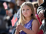 Braelyn Rhodes, 6, of Carson City, watches the annual Veterans Day parade in Virginia City, Nev., on Monday, Nov. 11, 2013.<br /> Photo by Cathleen Allison