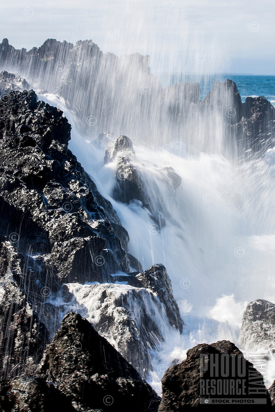 Powerful surf crashes on rocks along the rocky Kapoho coastline in Puna, Big Island of Hawai'i.