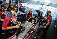 Sept. 16, 2012; Concord, NC, USA: NHRA crew members for top fuel dragster driver Shawn Langdon during the O'Reilly Auto Parts Nationals at zMax Dragway. Mandatory Credit: Mark J. Rebilas-