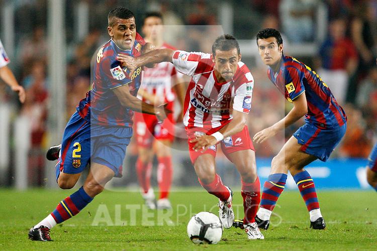 Sporting de Gijon's Diego Castro (r) and FC Barcelona's Daniel Alves during  La Liga match.August 31 2009. (ALTERPHOTOS/Acero).