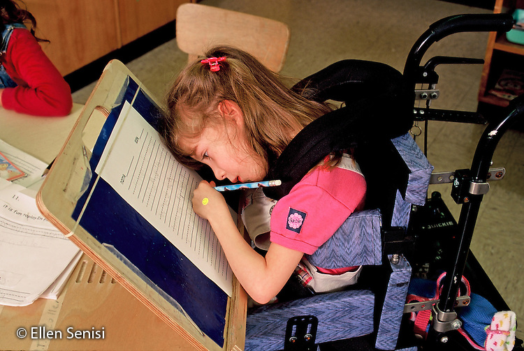 MR / Schenectady, NY.Zoller Public School / Inclusion class Grade 1.Girl (6, cerebral palsy) works at specially designed desk on her independent work..MR: Her4.© Ellen B. Senisi