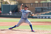 Surprise Saguaros starting pitcher Nate Pearson (20), of the Toronto Blue Jays organization, delivers a pitch during an Arizona Fall League game against the Salt River Rafters at Salt River Fields at Talking Stick on October 23, 2018 in Scottsdale, Arizona. Salt River defeated Surprise 7-5 . (Zachary Lucy/Four Seam Images)