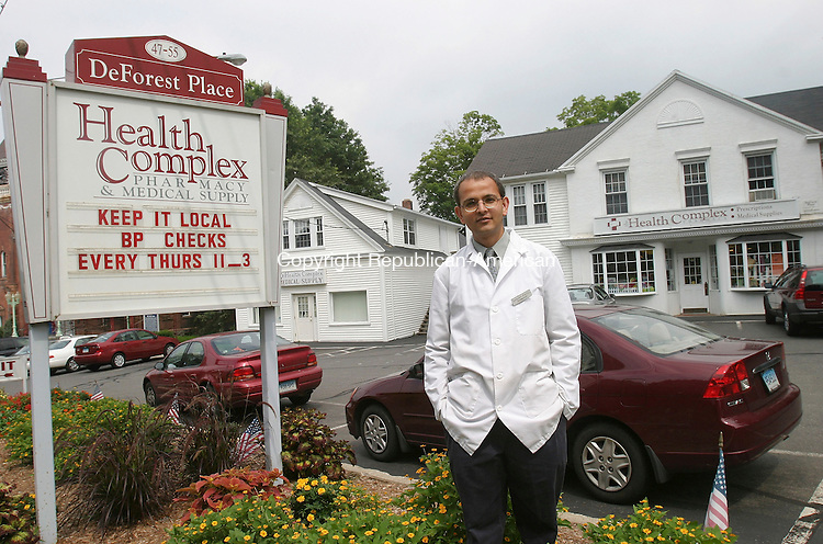 WATERTOWN, CT - 25 July 2005- 072505BZ01- Pharmacist Sanjay Patel poses in front of the Health Complex he recently purchased in Watertown.  <br /> Jamison C. Bazinet Photo