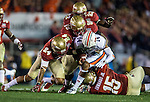 Seminole defenders Telvin Smith (22) Nile Lawrence-Stample (99), Terrance Smith, (24) and Mario Edwards, Jr., sack Auburn quarterback Nick Marshall in the first half of the BCS national title game at the Rose Bowl in Pasadena, California on January 6, 2014.   The Florida State Seminoles defeated the Auburn Tiger 34-31 to win the final BCS National Championship.