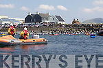 Kayackers push the first wave of swimmers back to the start line at Renard Point after a false start at the Valentia Triathlon, watched on by a Ballinskelligs Inshore Rescue Crew.