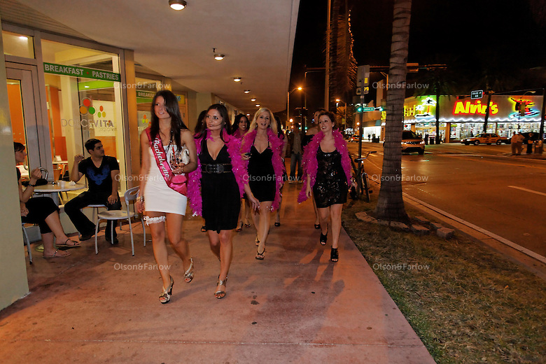 Lincoln Road night life--a bachelorette party walks along Collins Avenue after a dinner out on the town.