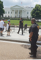 Washington DC, July 9, 2016, USA--Members of the Secret Service K-9 corps patrol the front of the White House.  Security has been increased after a spike in violence around the United States. Patsy Lynch/MediaPunch