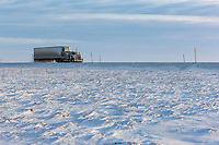 Semi tractor trailer, trucker travels the James Dalton Highway, the Haul road, near Prudhoe Bay, Alaska.