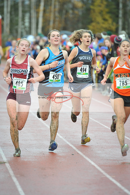 From left, Chugiak's Hannah Booher and Eagle River's Peyton Young arrive at the finish line of Saturday's championships.  Photo for the Star by Michael Dinneen