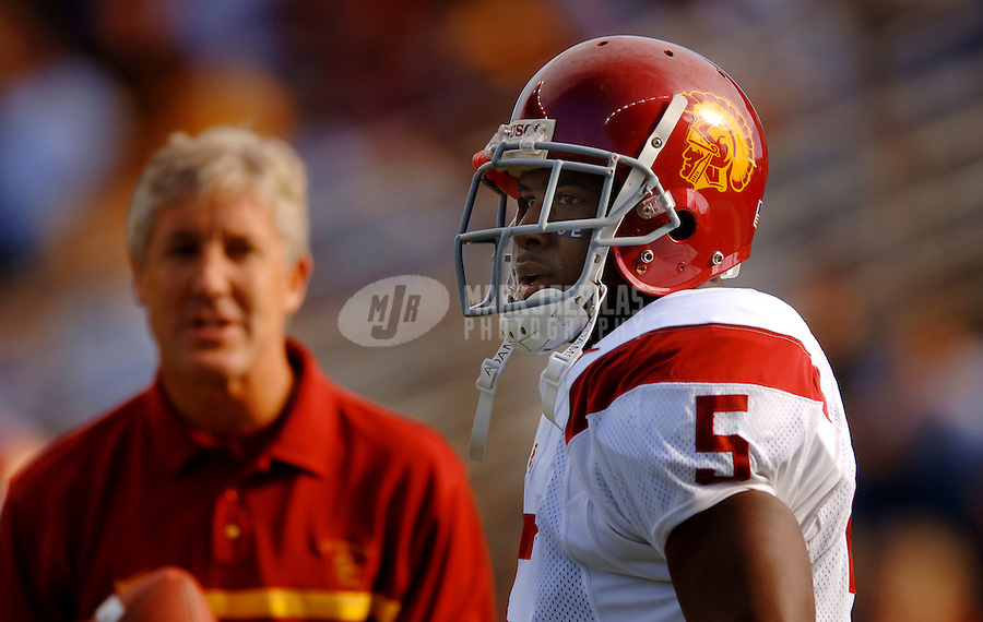 Oct 22, 2005; Seattle, WA, USA; Southern California Trojans head coach Pete Carroll talks with tailback #5 Reggie Bush prior to their game against the Washington Huskies at Husky Stadium. Mandatory Credit: Photo By Mark J. Rebilas