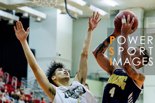 Bullen Christian Matthew #4 of Winling Basketball Club tries to score next to Tang Wing Lok #5 of Eagle Basketball Team during the Hong Kong Basketball League game between Eagle and Winling at Southorn Stadium on May 4, 2018 in Hong Kong. Photo by Yu Chun Christopher Wong / Power Sport Images