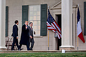 U.S. President Donald Trump, center, waves next to Emmanuel Macron, France's president, left, and Doug Bradburn, president and chief executive officer of George Washington's Mount Vernon, while touring outside the Mansion at the Mount Vernon estate of first U.S. President George Washington in Mount Vernon, Virginia, U.S., on Monday, April 23, 2018. As Macron arrives for the first state visit of Trump's presidency, the U.S. leader is threatening to upend the global trading system with tariffs on China, maybe Europe too. <br /> Credit: Andrew Harrer / Pool via CNP