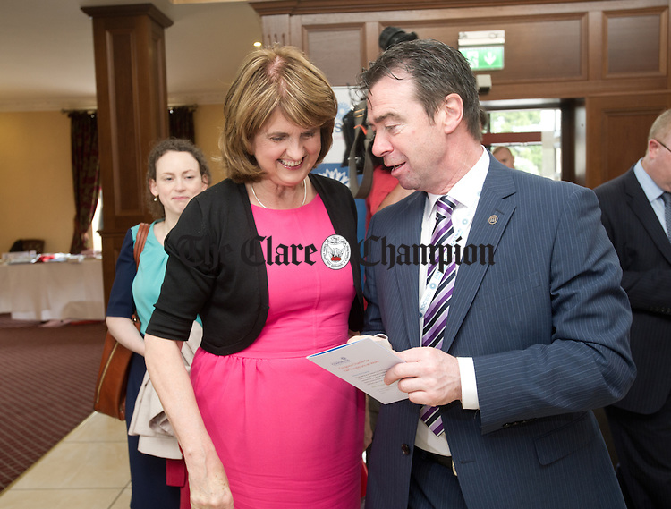 Joan Burton, Tanaiste and Minister for Social Protection chats with John Douglas, President ICTU on her arrival at the Irish Congress of Trade Unions' Biennial Delegate Conference in Treacey's West County Hotel. Photograph by John Kelly.