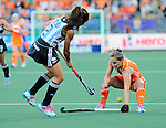 The Hague, Netherlands, June 12: Kelly Jonker #10 of The Netherlands defends against Mariana Rossi #2 of Argentina during the field hockey semi-final match (Women) between The Netherlands and Argentina on June 12, 2014 during the World Cup 2014 at Kyocera Stadium in The Hague, Netherlands. Final score 4-0 (3-0)  (Photo by Dirk Markgraf / www.265-images.com) *** Local caption ***