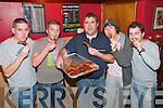 Beauty of Irish Pork Pub Grub : Christy Walsh, centre, The Well Bar , Listowel dishing out spare ribs to Ryan Allman, Aengus Fitzgerald , Sheamus Keane and Conor O'Neill during the Listowel Food Fair weekend.