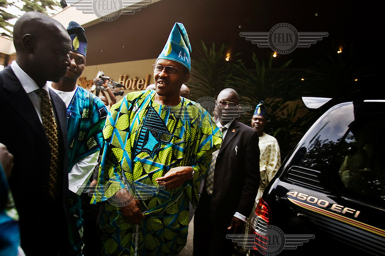 Former military ruler Muhammadu Buhari of the All Nigeria People's Party (ANPP) goes to a rally in Abeokuta in traditional Yoruba dress..