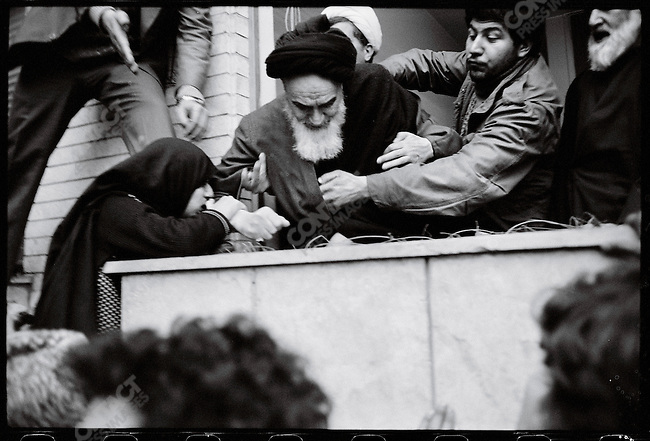 An overzealous woman nearly pulls Ayatollah Khomeini out of the window at the Refah School. Tehran, February 2, 1979
